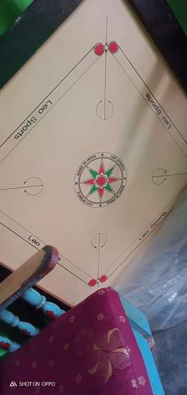 5 month old carrom board , lole he contact koribo