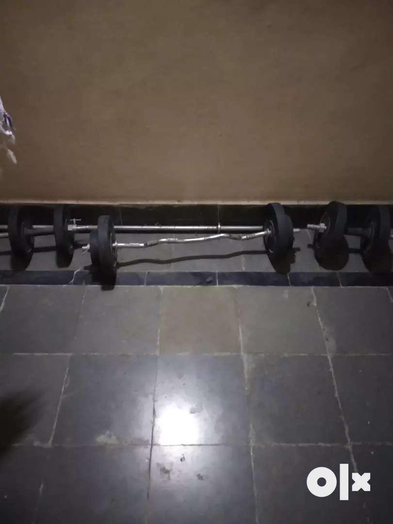 12 kg weights, 1 curl rod, 1 shoulder rod, 2 dumbbell rods 0