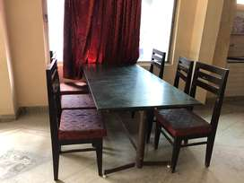 Dining table with 100 custom made silver oak wood chairs