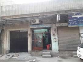 11 Marla commercial Corner House with 5 shops Double Story
