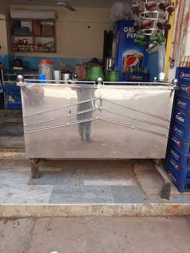 Slightly used heavy duty Chai Counter with 3 burners for sale.
