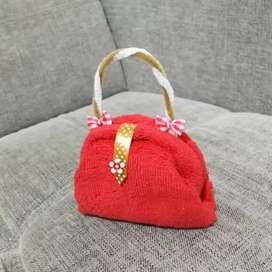 Souvenir handuk model tas