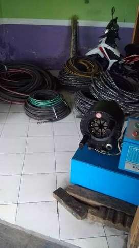 Mesin press selang