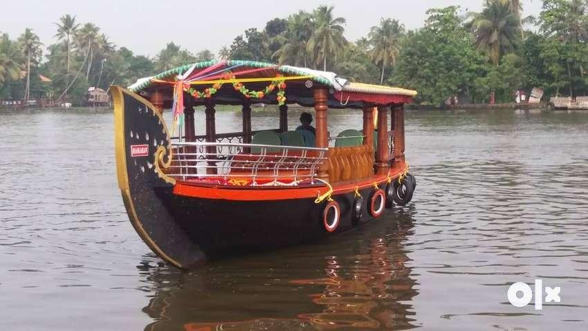Boating in Allepey, kuttanad backwaters, shikkara boat one day cruise. 0