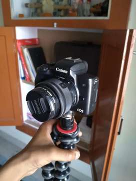 Canon m50 with canon mount and 15-54 mm lense