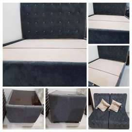 Double bed with chairs and coffee table