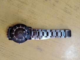 Wrist watch with rotating flower in the dial