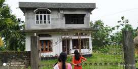 Sell of house building situated at Kachubhill Gaon.