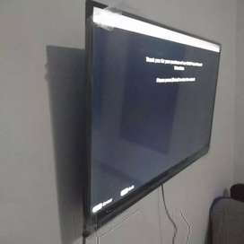 foto hasil pasang bracket tv sharp 40inc  pakai bracket standar