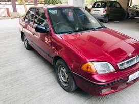 Red Maruti Esteem 2000 Model with 98000km running in good condition