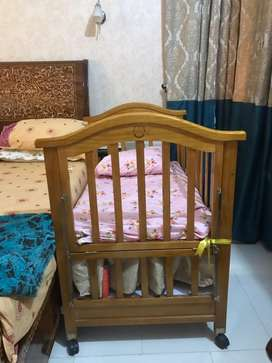 Baby cot with cradle and mosquito net
