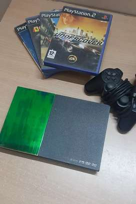 Sony Ps2 (A1 Condition) With Original Games.