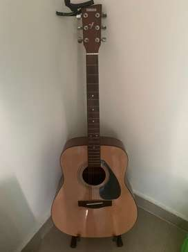 New Yamaha Guitar F310 with guitar stand price negotiable