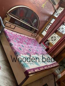 Wooden bed with a dressing table