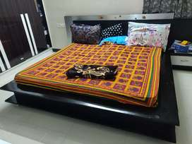 Low rise king size platform bed with storage and side tables