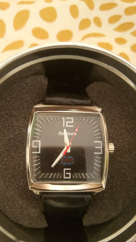 reebok watch just 2day used with original box