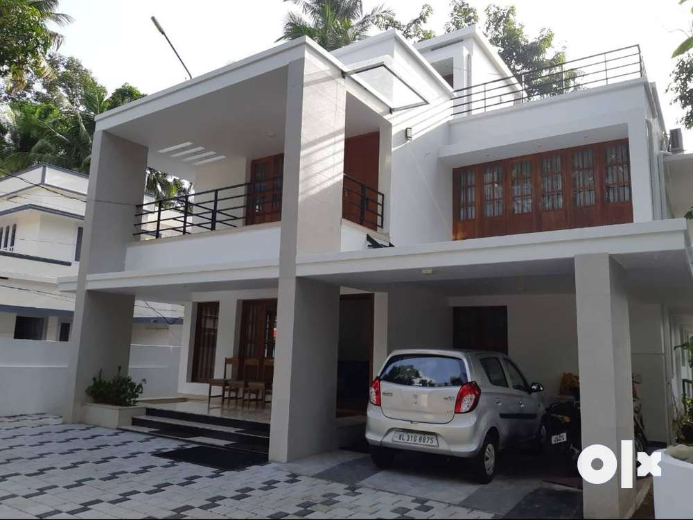 bright and spacious open concept 3 storied house in karunagapally