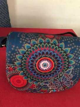 Navy blue leather sling bag