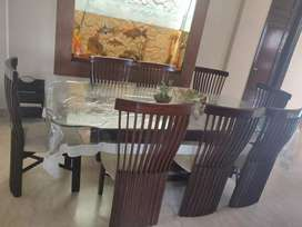 Glass top 8 seater dining table
