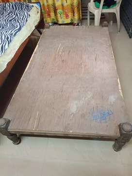 Teak wood bed with plywood sheet
