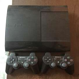 Playstation 3 with 8 games and 2 controllers