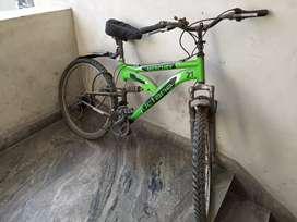 Spur.neon green bike.service needed.