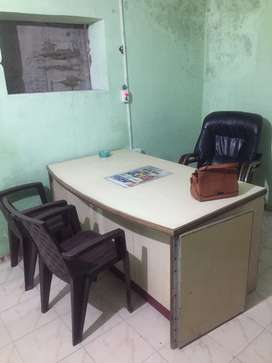 Office table with boss chair and side chairs