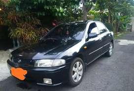 Mazda Familia tahun 98 warna hitam