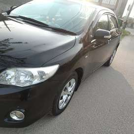 Black Corolla 2013 for rent in mansehra with driver.