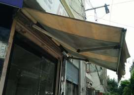Umbrella and mirrors for a shop or house