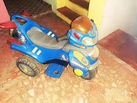 Kids driving  scotter