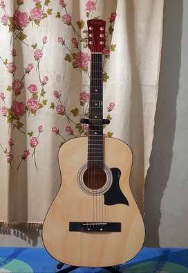 Brand new acoustic guitar: price negotiable.