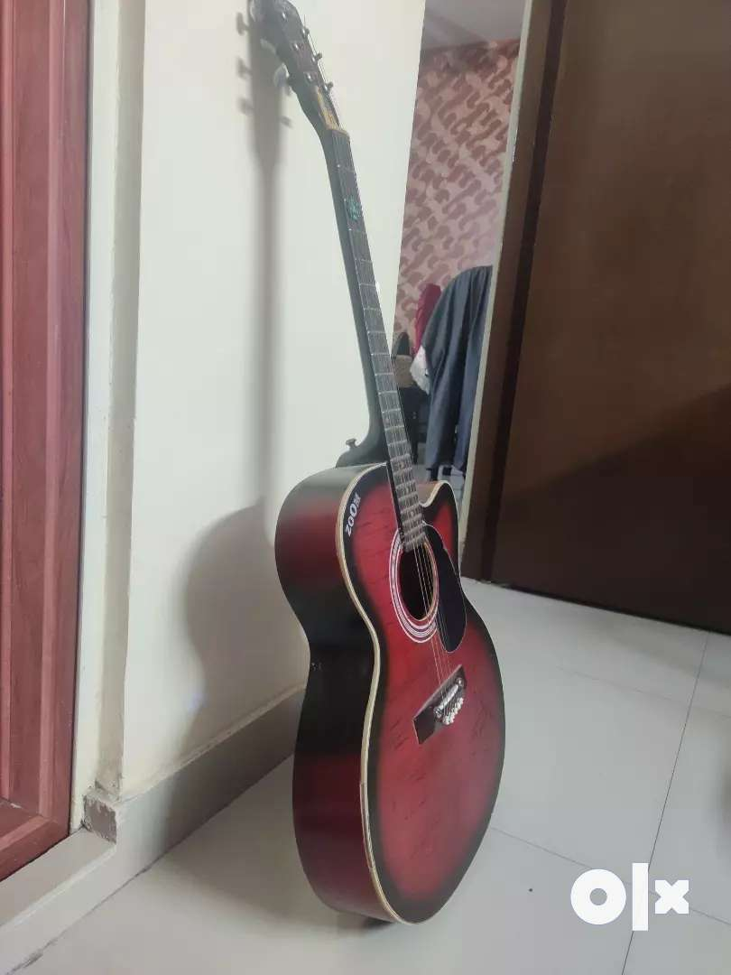 Acoustic guitar with a super condition and almost new 0
