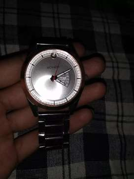 New Watch good condition company.MOVADO  ,seen day, date, mast Hain ..