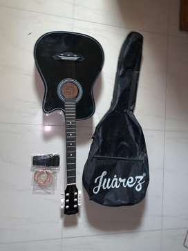 Guitar with strap, chords and bag.
