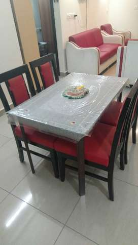 Stylish 4 seater wooden dining table