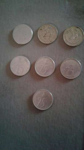 Seven 25 Indian Paise Coins