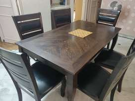 Wooden dining table with 6 chairs at 10000/-