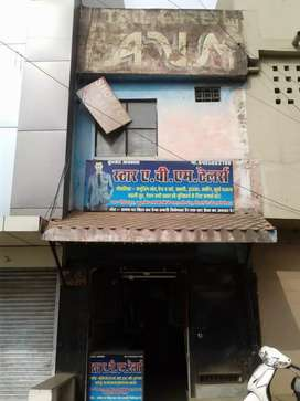 Urgently selling double story building with Shop