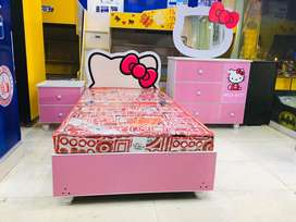 single bed with side table and dressing table