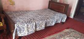 Two single beds in lush condition