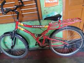 Hero brand red colour double shocker bicycle