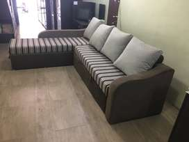 Corner cum bed in very rich colour combination