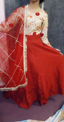Skerts in deep red colour with dull gold combination with gota dupatta