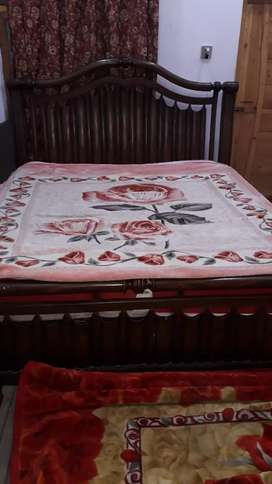 King size wooden bed with 2 side tables and mattress