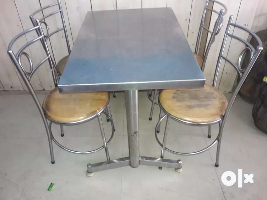 Four seated steel table chair for sale 0