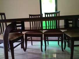 Wooden Dining Table with six seating capacity (teak) in good condt.