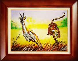 painting of cheetah chassing a gazelle