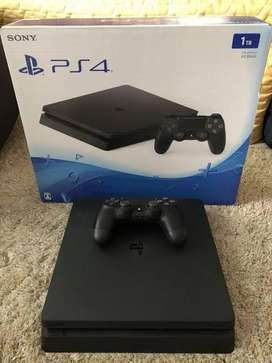 Playstation 4 slim 1tb with 2 original controllers and spiderman game
