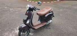 Vespa LX150ie 2V coklat tahun 2012